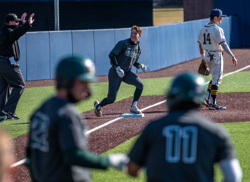 Freshman infielder Mitch Jebb (41) steals third base in the second inning. The Wolverines made a comeback in the ninth inning to top the Spartans 8-7 at Ray Fisher Stadium on Mar. 21, 2021.