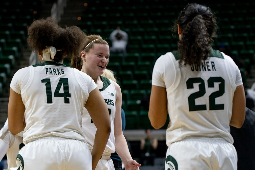 <p>Then-freshman guard Julia Ayrault (40) celebrates with the bench during the game against Oakland on Nov. 19, 2019, at Breslin Center. The Spartans defeated the Golden Grizzlies, 76-56.</p>