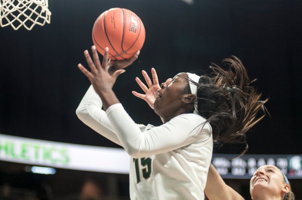 Freshman forward Victoria Gaines (15) attempts a shot during an exhibition game against Northwood University on Nov. 6, 2016 at the Breslin Center. The Spartans defeated the Timberwolves 82-47.