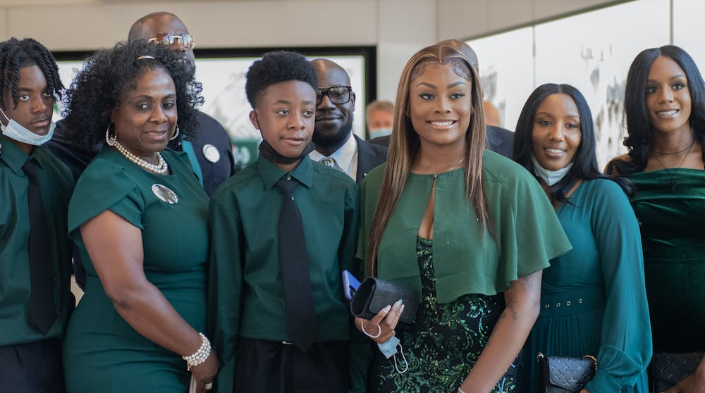<p>Charles Rogers&#x27; family poses for a picture after revealing his hall of fame plaque at Clara Bell Smith Center on Sept. 24, 2021.</p>