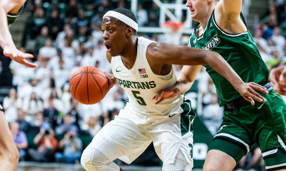 <p>Senior guard Cassius Winston (5) drives to the lane against Binghamton. The Spartans lead the Bearcats 51-23 at halftime at the Breslin Student Events Center on Nov. 10, 2019. </p>