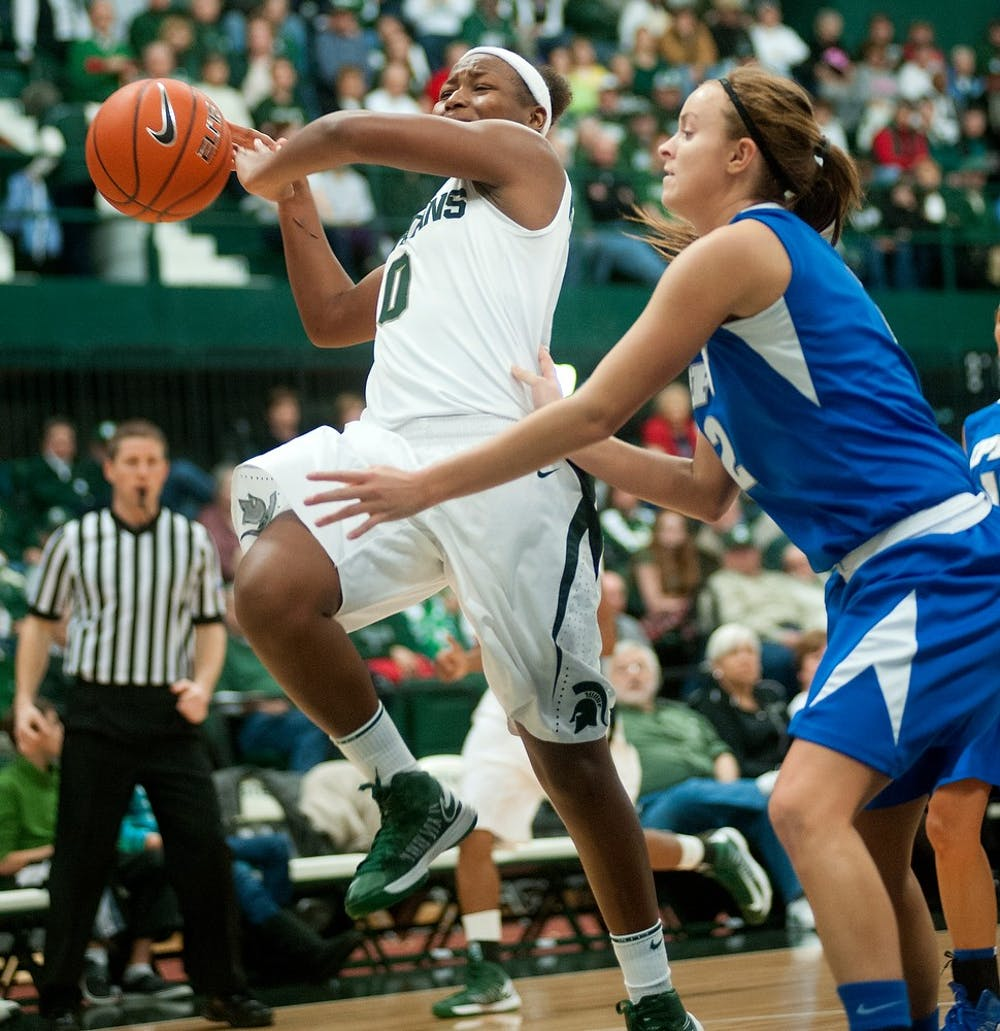 """<p><span class=""""caps"""">IPFW</span> guard Rachel Mauk pushes sophomore guard Kiana Johnson out of bounds in the second half of the game. The Spartans defeated the Mastodons, 64-36, Sunday, Dec. 16, 2012, at Jenison Field House. Justin Wan/The State News</p>"""