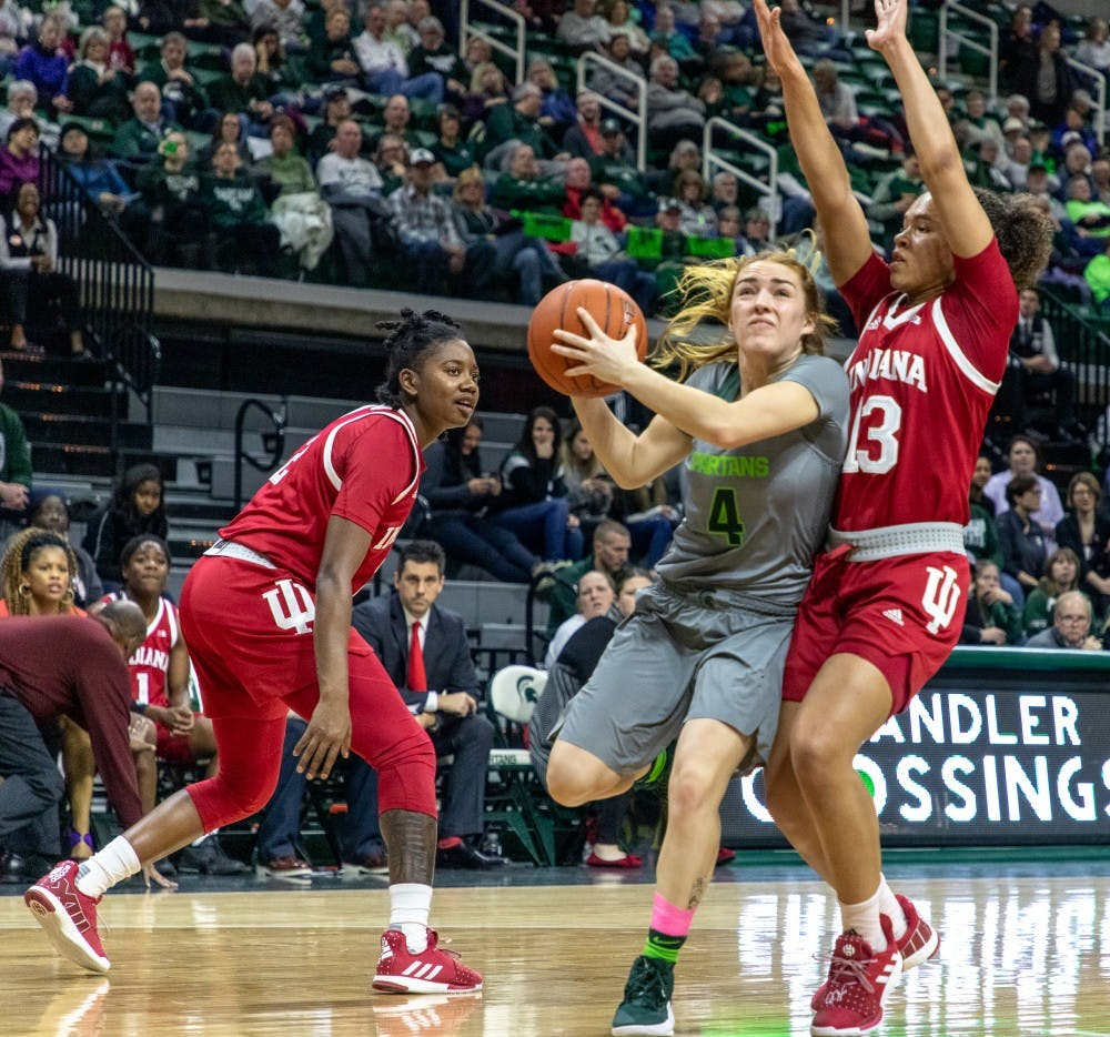 Junior guard Taryn McCutcheon (4) draws contact during the game against Indiana on Feb.11, 2019. The Spartans lead the Hoosiers 33-30 at halftime.