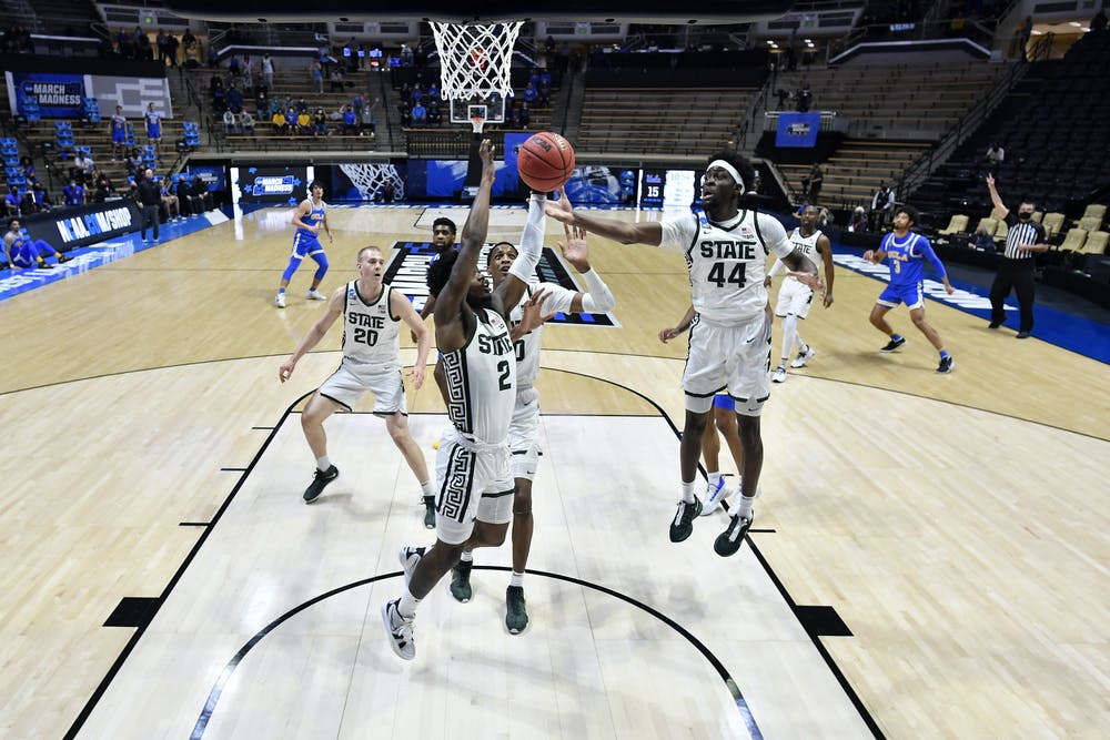 <p>WEST LAFAYETTE, IND. — MARCH 18: Gabe Brown (44) of the Michigan State Spartans grabs a rebound against the UCLA Bruins in the First Four round of the 2021 NCAA Division I Men's Basketball Tournament held at Mackey Arena. (Photo by Andy Hancock/NCAA Photos via Getty Images)</p>