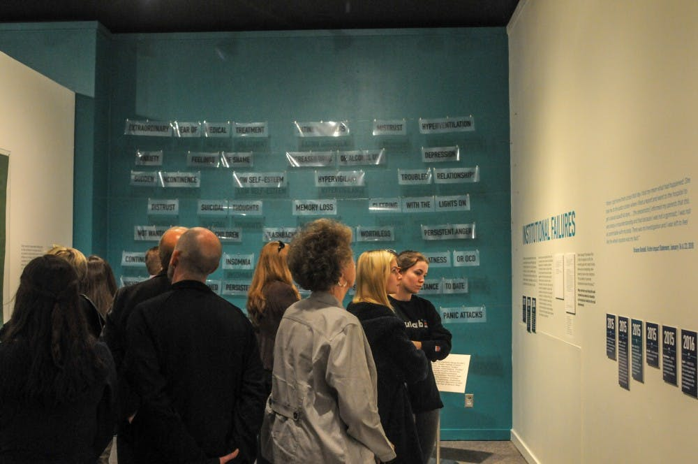 People view the exhibit during the Finding Our Voice: Sister Survivors Speak Exhibition Opening Ceremony at the MSU Museum on April 16, 2019.