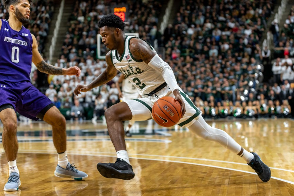 Freshman guard Rocket Watts (2) drives on Northwestern's Boo Buie (0).The Spartans defeated the Wildcats, 79-50, at the Breslin Student Events Center on January 29, 2020.
