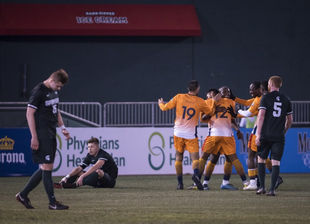 Lansing Ignite players celebrate a goal during the second half of the Capital Cup against Michigan State men's soccer team at Cooley Law School Stadium in Lansing on Tuesday, April 16, 2019. Michigan State was defeated by Lansing Ignite, 4-0. (Nic Antaya/The State News)