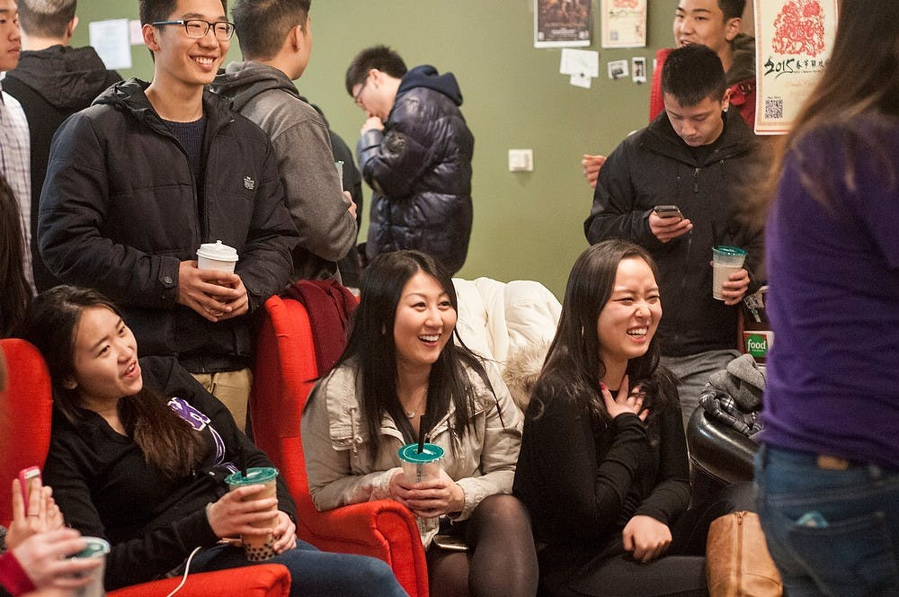 <p>Finance junior Chelsea Chiu, left, and human resource management freshman Tina Lee, center, laugh Jan 23, 2015, at 303 Albert St in East Lansing during the Lambda Phi Epsilon Spring Rush Event. Kennedy Thatch/The State News</p>