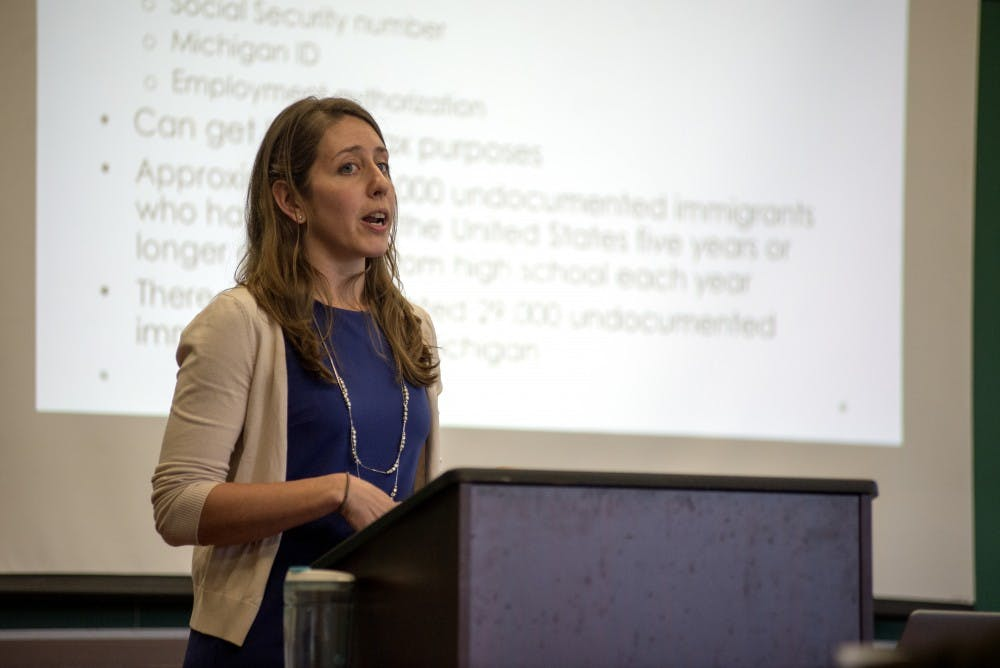 <p>Michigan Immigrant Rights attorney Anna Hill speaks to student and community members about immigration and education laws on April 18, 2016 at Wonders Hall.</p>