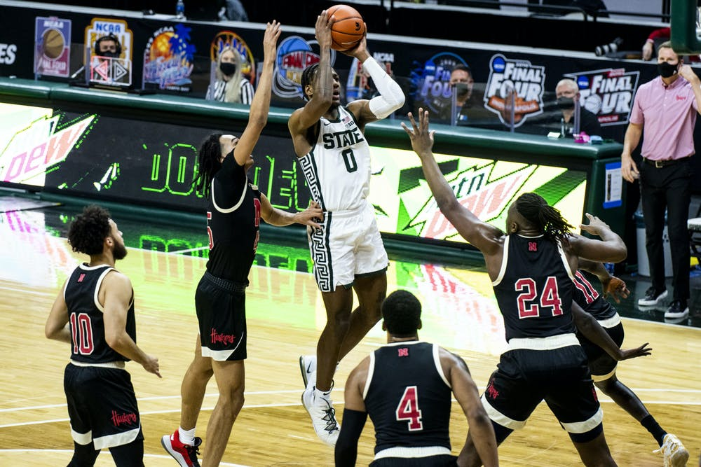 <p>Forward Aaron Henry (0) makes a shot during the game against Nebraska on Feb. 6, 2021, at the Breslin Center. The Spartans defeated the Cornhuskers, 66-56.</p>