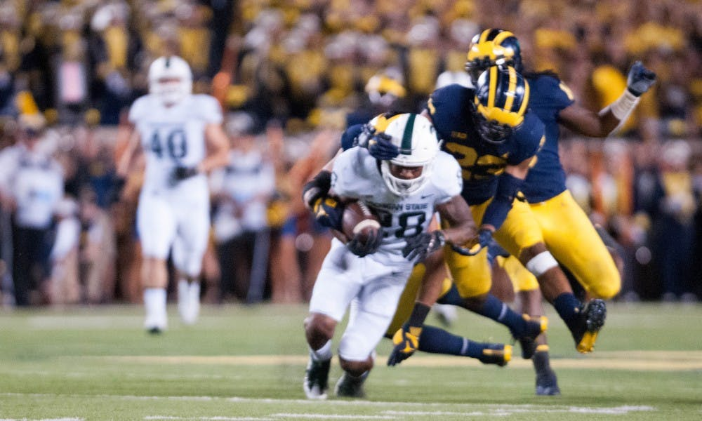 Rushing attack leads Spartans to a 14-10 victory over