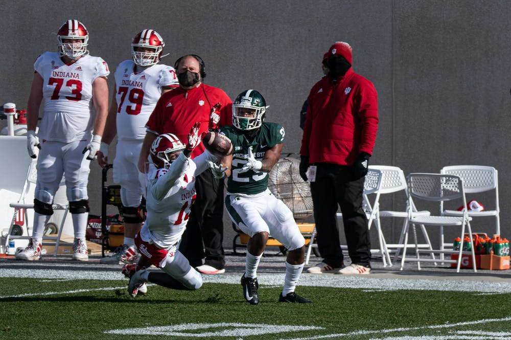 Cornerback, Shakur Brown (29) intercepts a Hoosier pass meant for Indiana wide reciever, Miles Marshal (13).