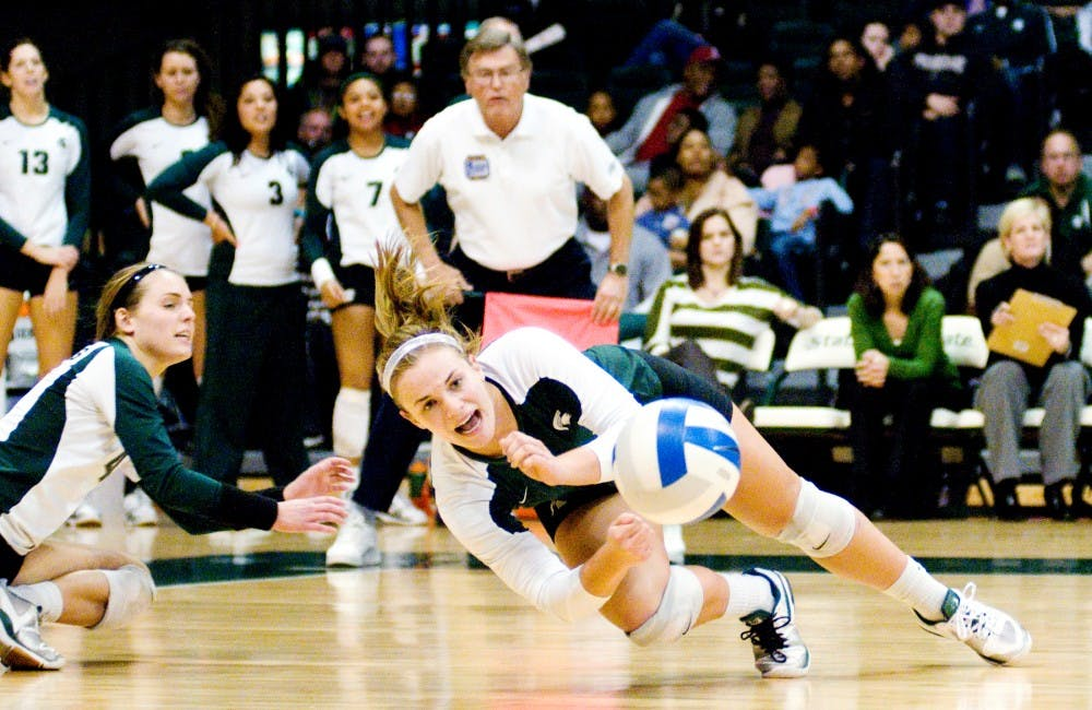 Freshman defensive specialist and libero Kori Moster falls to the floor after attempting to dig the volleyball. The Spartans fell against the Boilermakers, 3-1, Saturday night at Jenison Field House. Justin Wan/The State News