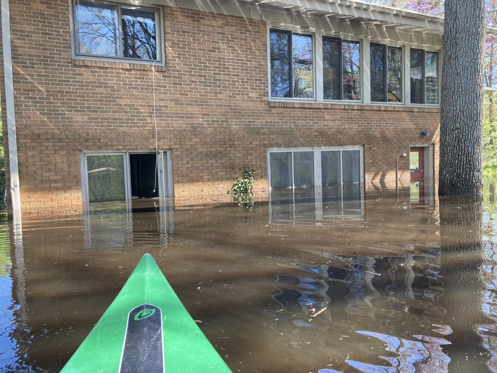 <p>Photo courtesy of MSU student Megan Arlt. The outside view of a rental home in Midland as Arlt kayaked through the flood water. </p>