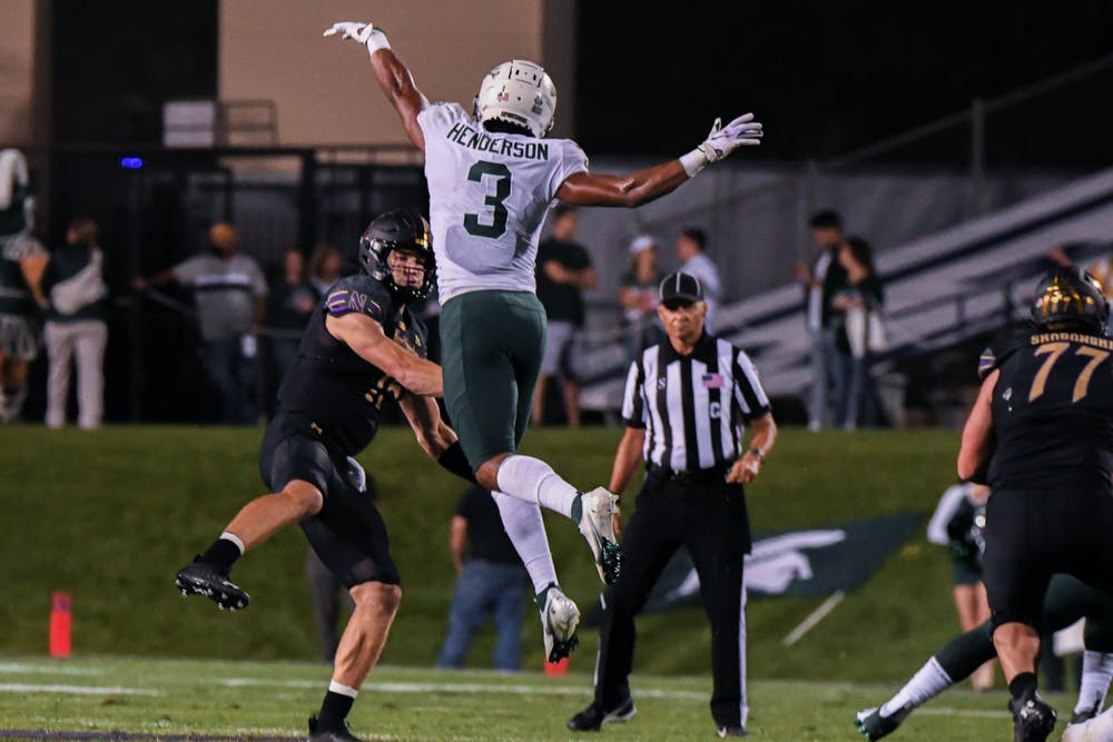 <p>Senior saftey Xavier Henderson disrupts the throw during the Spartans' game at Northwestern on Sept. 3, 2021.</p>