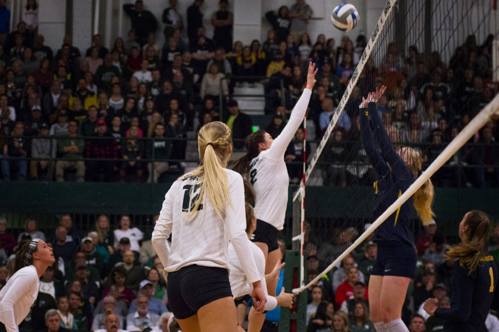 Junior outside hitter Autumn Bailey (2) hit the ball over the net during the game against Michigan on Nov. 12, 2016 at Jenison Fieldhouse. The Spartans defeated the Wolverines, 3-1.