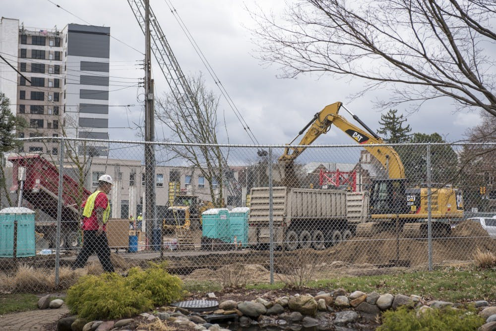 <p>Constructions workers work at the Park District project in East Lansing on April 12, 2019. (Nic Antaya/The State News)</p>