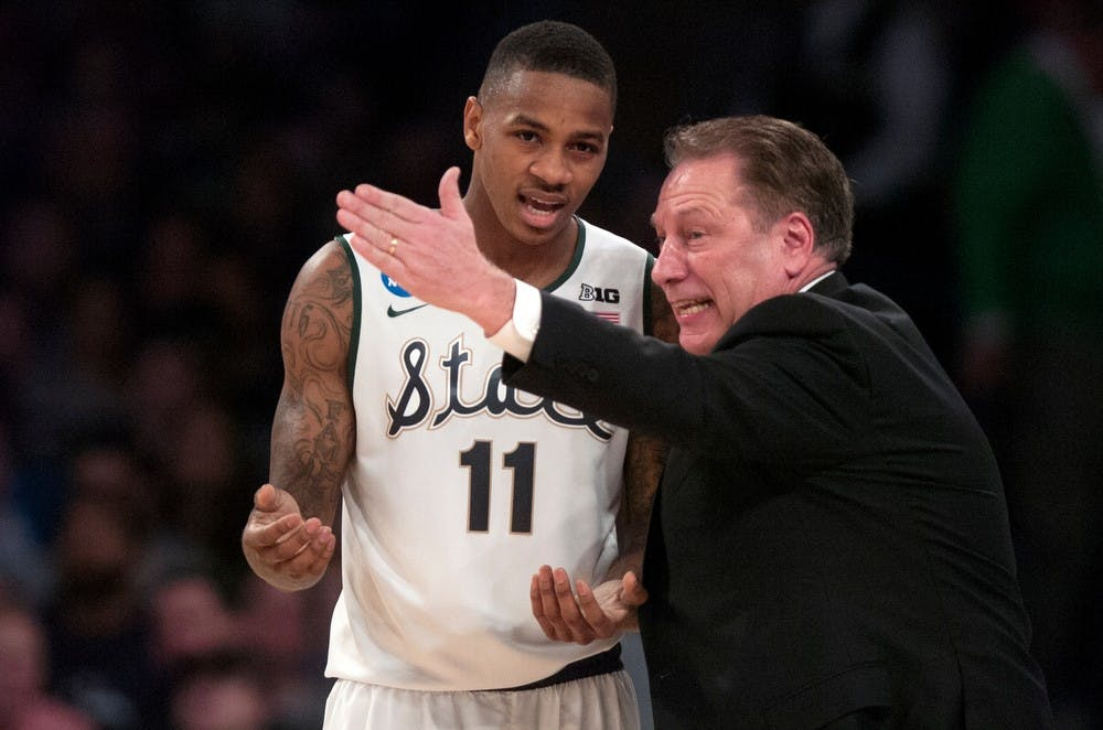 <p>Head Coach Tom Izzo talks to senior guard Keith Appling during the game against Connecticut on March 30, 2014, at Madison Square Garden in New York City. The Spartans lost in the Elite Eight, 60-54. Julia Nagy/The State News</p>