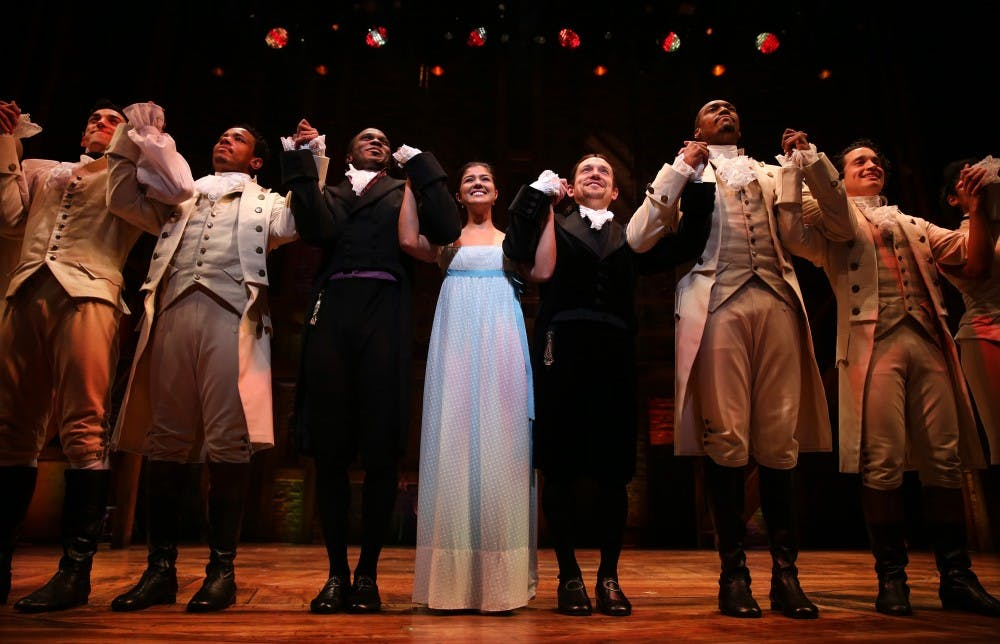 The cast of Hamilton takes a bow during a curtain call as the production makes its Chicago premiere on Wednesday, Oct. 19, 2016 at PrivateBank Theatre in Chicago, Ill. (Chris Sweda/Chicago Tribune/TNS)