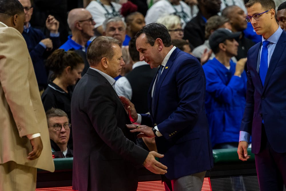 <p>MSU Had Coach Tom Izzo (left) and Duke Head Coach Mike Kryzewski interact following Duke defeating MSU. The Blue Devils defeated the Spartans, 87-75, at the Breslin Student Events Center on Dec. 3, 2019. </p>
