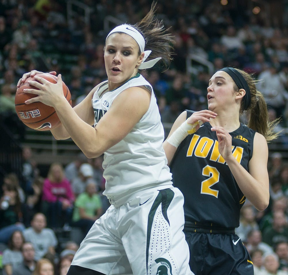 <p>Sophomore guard Tori Jankoska tries to maintain possession of the ball from Iowa guard Ally Disterhoft Jan. 18, 2015, during the game against Iowa at Breslin Center. The Spartans were defeated by the Hawkeyes, 52-50. Erin Hampton/The State News</p>