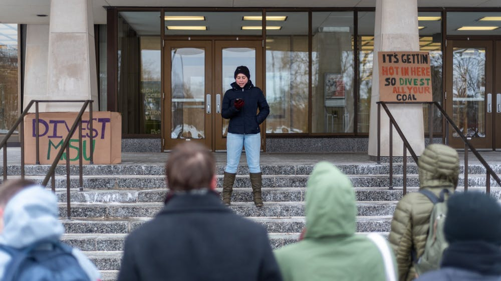 <p>A protestor speaks to an audience during a divestment day protest outside of the Hannah Administration Building on Feb. 14, 2020. </p>