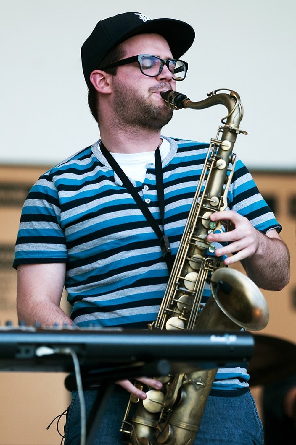 <p>Lansing resident Ryan Freitas plays the saxophone June 6, 2014, at Lake Lansing Band Shell in Lake Lansing Park South in Meridian Charter Township, Mich. Music for the event was provided by Lansing-based musical group, Soulstice. Corey Damocles/The State News</p>