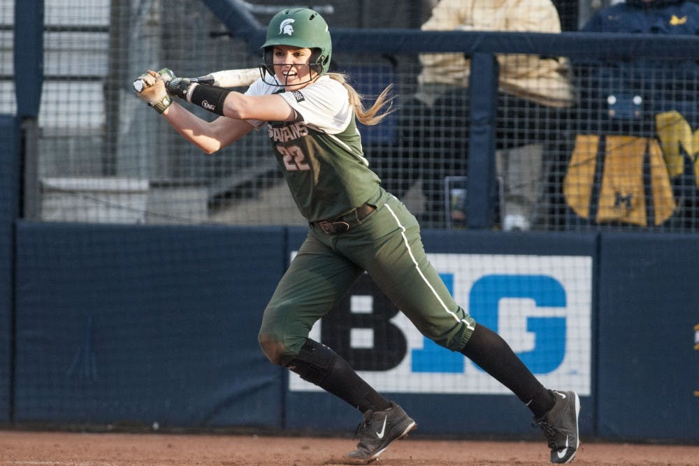 <p>Junior second baseman McKenzie Long (22) swings the bat during the game against University of Michigan on April 18, 2017 at Wilpon Baseball and Softball Complex in Ann Arbor. The Spartans were defeated by the Wolverines, 3-1. &nbsp;</p>