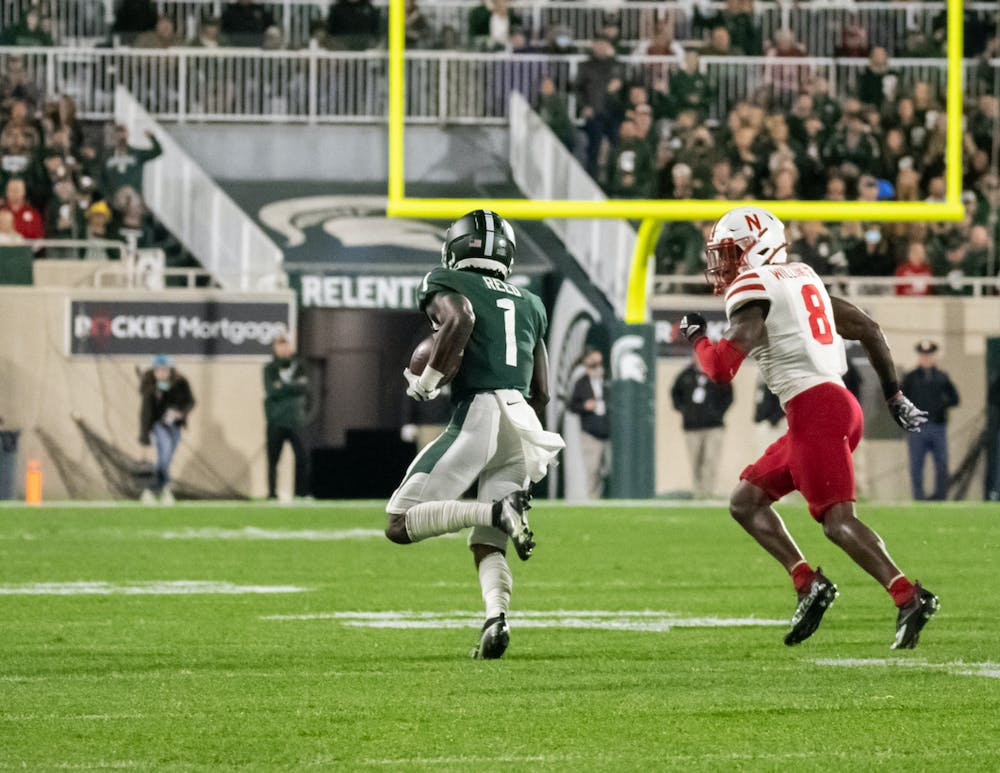 <p>Michigan State&#x27;s redshirt junior wide receiver Jayden Reed (1) runs the ball towards the endzone on Sept. 25, 2021.</p>