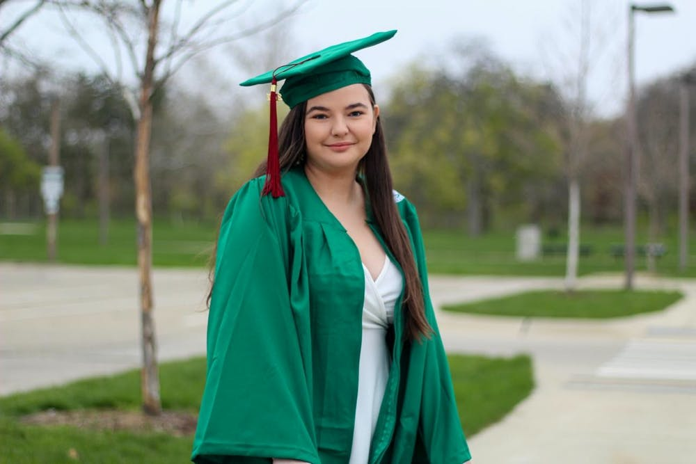 Senior Emily Bevard poses in her cap and gown.