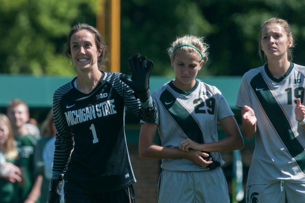 Senior goalkeeper Kaitlyn Collin (1) waves during pre-game introductions before a game against the University of Detroit on Sept. 11, 2016 at DeMartin Stadium at Old College Field. The Spartans defeated the Titans, 2-0.