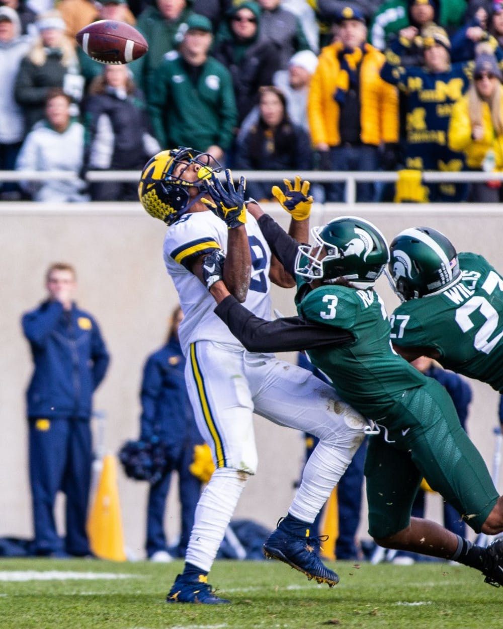 <p>Then-reshman safety Xavier Henderson (3) defends a pass to Michigan receiver Donovan Peoples-Jones (9) during the game at Spartan Stadium on Oct. 20, 2018. The Wolverines defeated the Spartans, 21-7.</p>