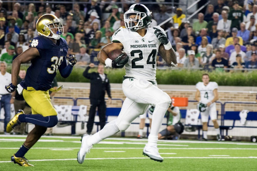 Senior running back Gerald Holmes (24) runs for a touchdown during the game against Notre Dame on Sept. 17, 2016 at Notre Dame Stadium in South Bend, Ind.  The Spartans defeated the Fighting Irish, 36-28.