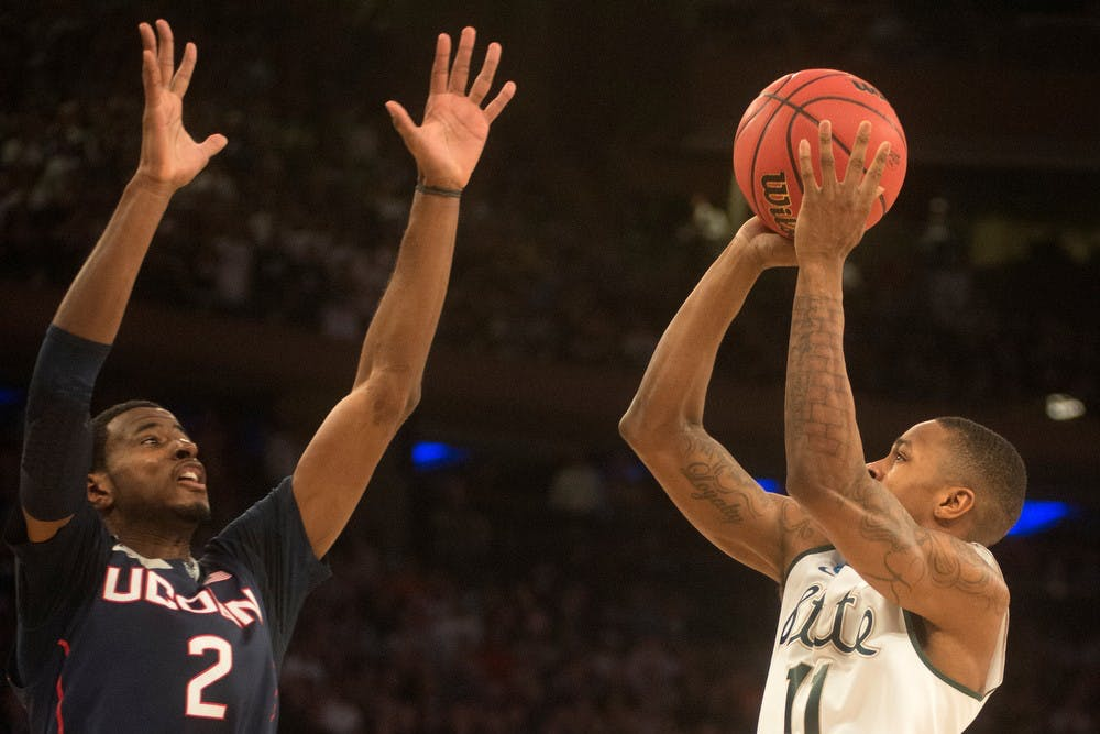 <p>Senior guard Keith Appling goes up to the basket as Connecticut forward DeAndre Daniels guards March 30, 2014, at Madison Square Garden in New York City. The Spartans lost in the Elite Eight, 60-54. Julia Nagy/The State News</p>