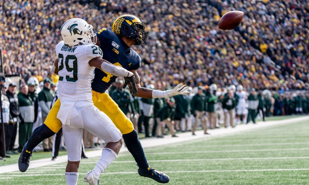 Sophomore cornerback Shakur Brown (29) interferes with Michigan wide receiver Nico Collins (4).
