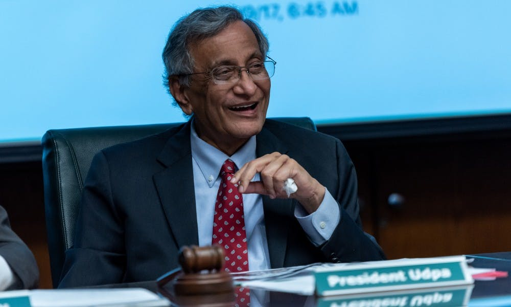 <p>Satish Udpa smiles during his final Board of Trustees meeting on June 21, 2019 at the Hannah Administration Building.</p>