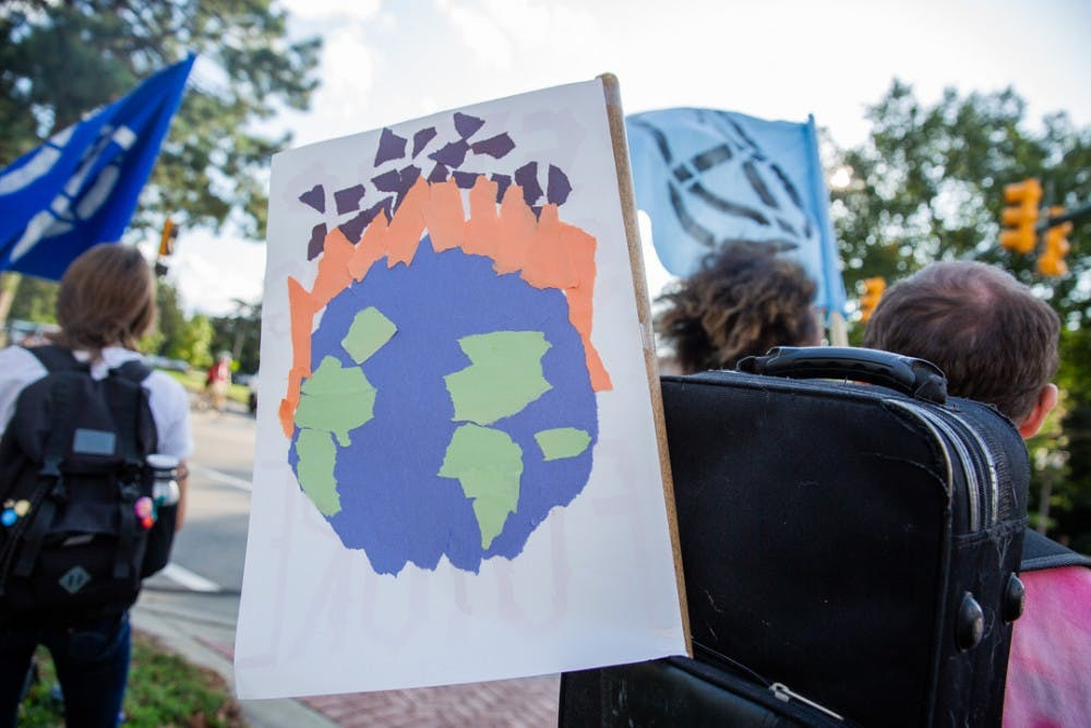 <p>The East Lansing Extinction Rebellion group held a rally calling for action on climate change on Sept. 23, 2019 on Grand River Avenue.</p>