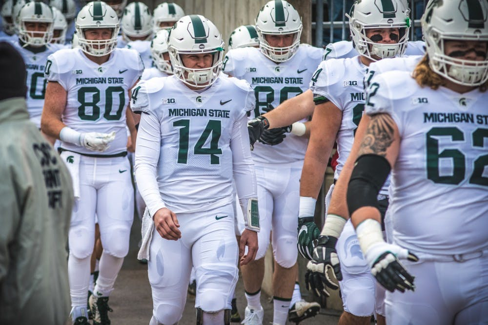 <p>Quarterback Brian Lewerke (14) walks onto the field before the game against Ohio State, on Nov. 11, 2017, at Ohio Stadium. The Spartans were defeated by the Buckeyes, 48-3.</p>