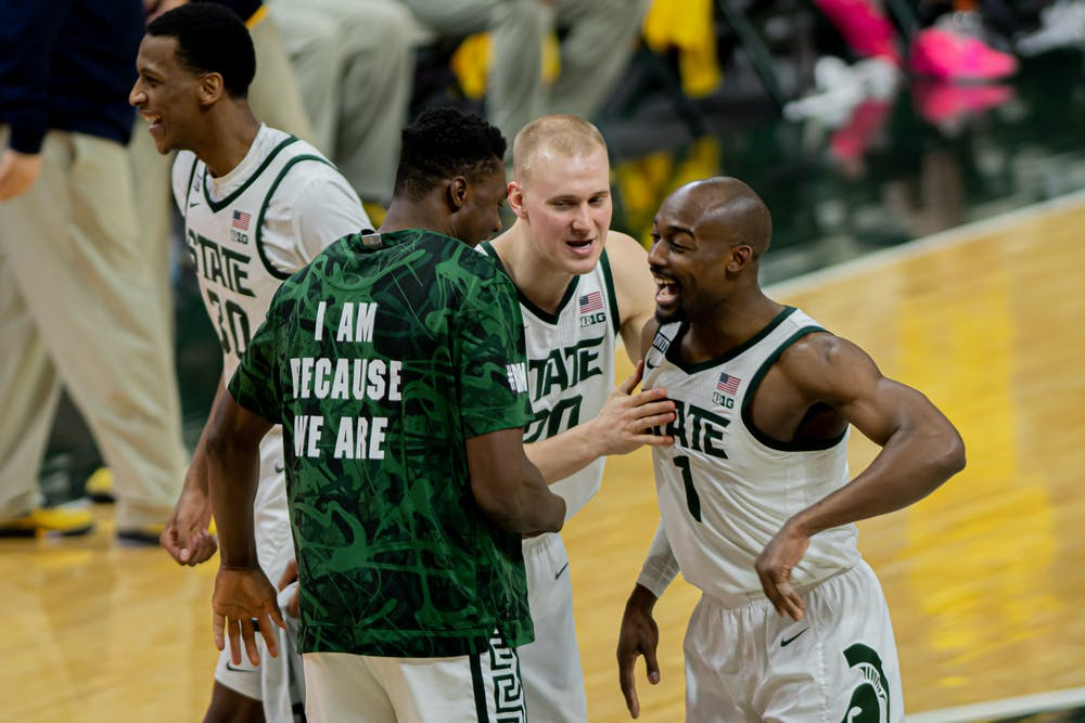 <p>Redshirt senior guard Joshua Langford (1) celebrates with freshman forward Mady Sissoko and junior forward Joey Hauser after the Spartans&#x27; upset of No. 2 Michigan on March 7, 2021. A Langford three-pointer iced the game.</p>