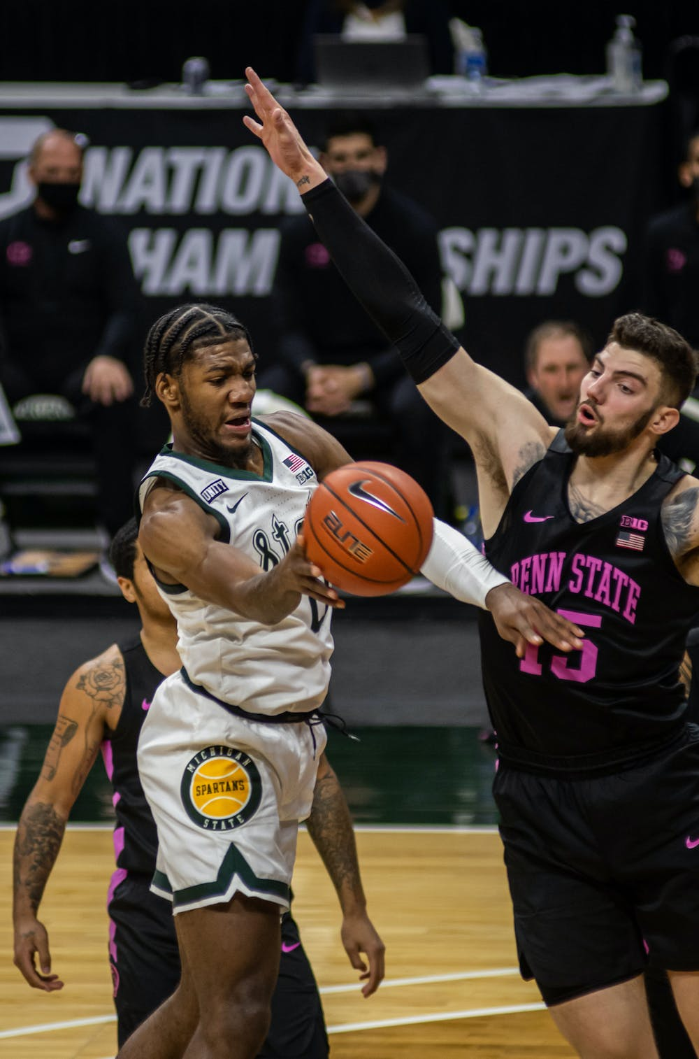 <p>Junior forward Aaron Henry drives into the lane and passes. Henry&#x27;s 20-point night helped the Spartans win against Penn State on Feb. 9, 2021.</p>