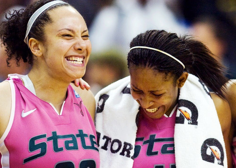 Senior forward Kalisha Keane laughs with senior forward Cetera Washington after defeating Michigan Sunday night at Breslin Center. Keane put up 18 points for the Spartans in their 69-56 victory over the Wolverines. Matt Hallowell/The State News