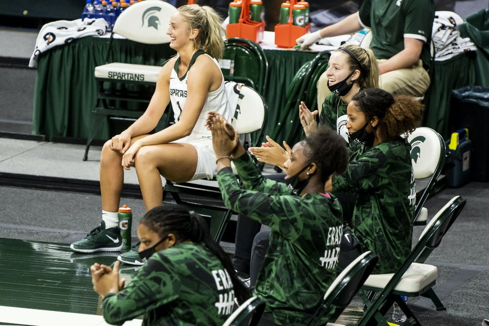 <p>Players on MSU&#x27;s women&#x27;s basketball team cheer for their teammates during their game against Detroit Mercy on Dec. 02, 2020.</p>