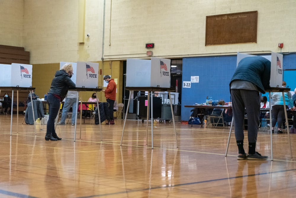 <p>Voters at Southside Community Center polling location filling out ballots Tuesday, Nov. 3, 2020.</p>