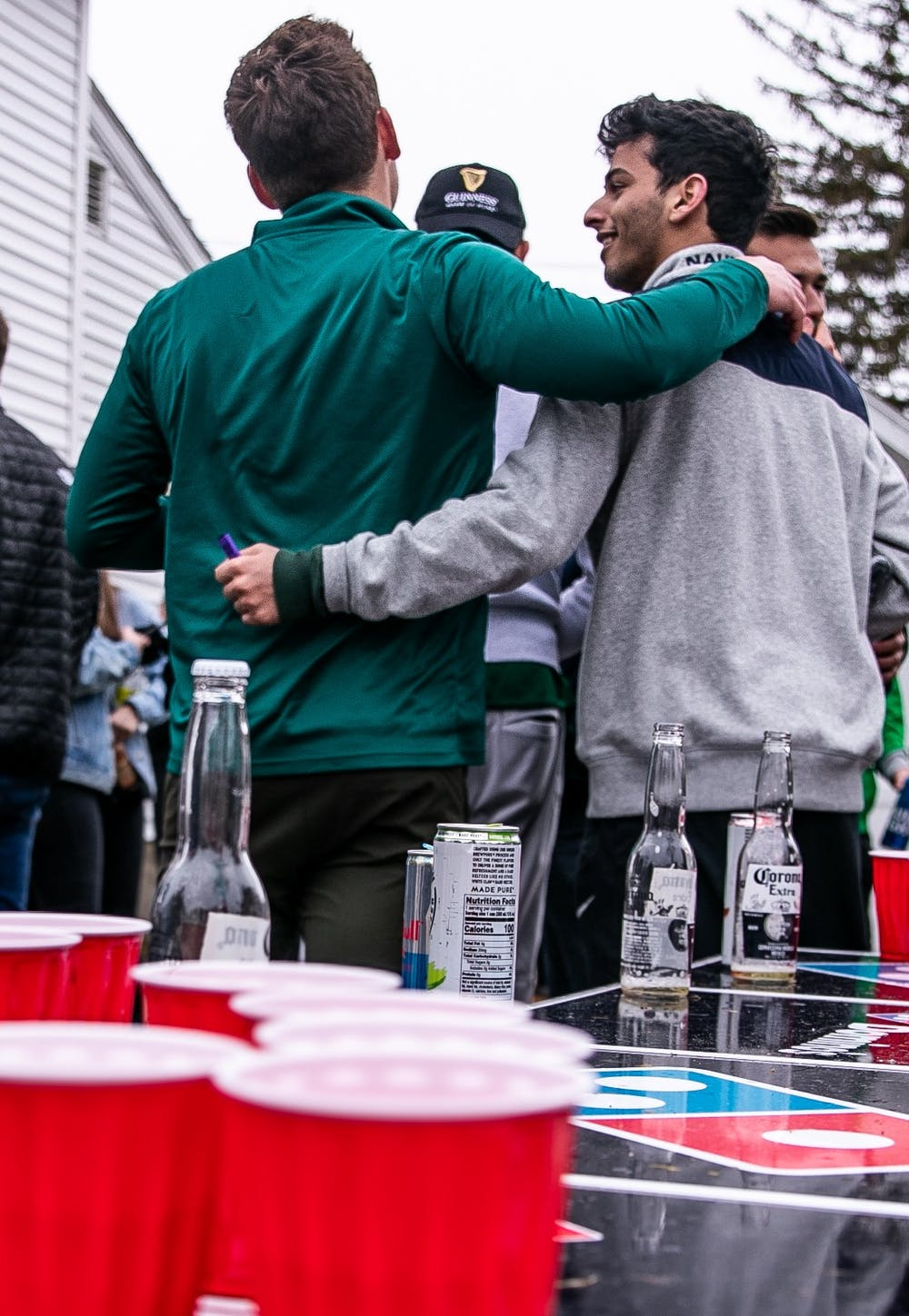 Students party at housing near MSU on the Saturday before St. Patrick's Day despite health warnings related to COVID-19.