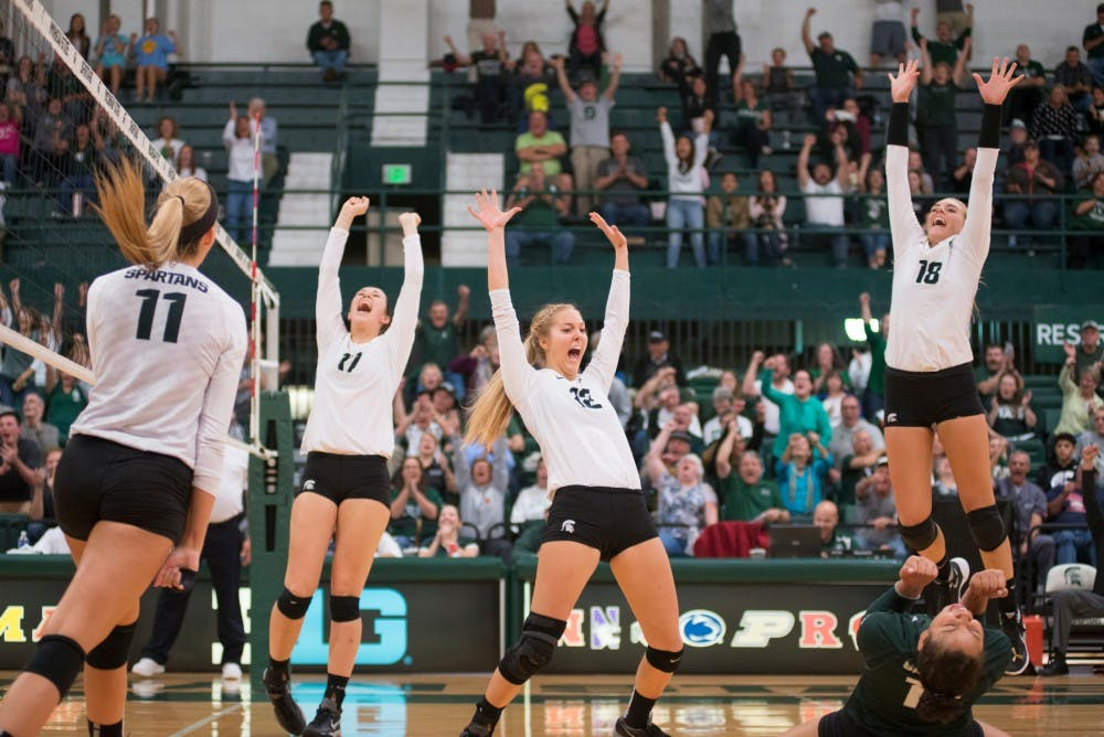 <p>Left to right, junior outside hitter Chloe Reinig, sophomore middle back Alyssa Garvelink, sophomore setter Rachel Minarick, sophomore libero Abby Monson and sophomore outside hitter Holly Toliver celebrate the final play during the volleyball game against Ohio State on Oct. 21, 2015 at Jenison Field House. The Spartans defeated Ohio State, 3-0.</p>