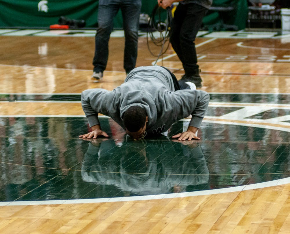 <p>Alumnus Miles Bridges kisses the Spartan head prior to the mens basketball game against Maryland on Jan. 21, 2019 at Breslin.</p>