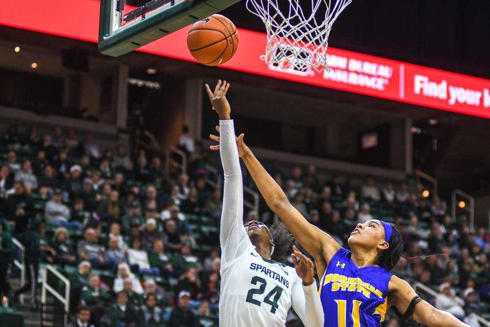 <p>Sophomore guard Nia Clouden (24) shoots the ball during the game against Morehead State on Dec. 15, 2019 at Breslin Center. The Spartans defeated the Eagles, 93-48.</p>