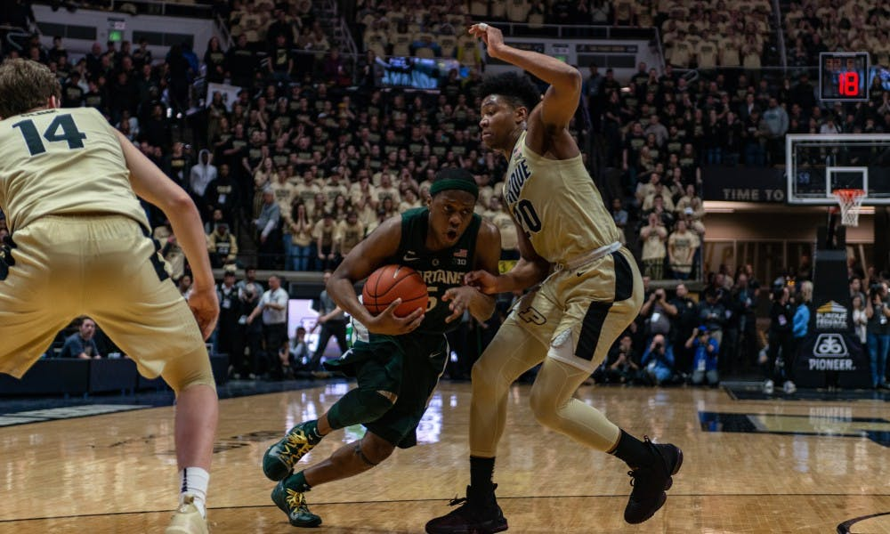 Junior guard Cassius Winston (5) drives on Purdue's Nojel Eastern at Mackey Arena on Jan. 27, 2019. The Spartans fell to the Boilermakers 73-63.