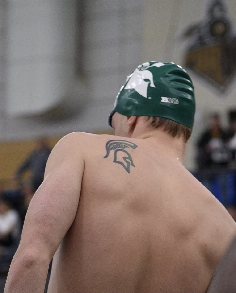 Phillip Meffert prepares for one of his events during a swim meet while in college. Meffert is a senior, the tattoo on his left shoulder is a long-time tradition for members of the Swim & Dive program to get while competing for Michigan State. (Credit: Phillip Meffert / Courtesy)
