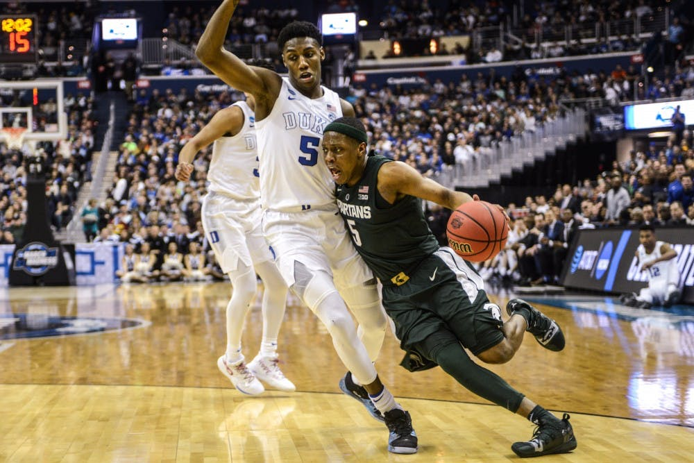 Junior guard Cassius Winston (5) runs with the ball against Duke's forward RJ Barrett (5) during the game against Duke at Capital One Arena on March 31, 2019. The Spartans defeated the Blue Devils, 68-67. The Spartans are the East Regional Winners and are headed to the Final Four.